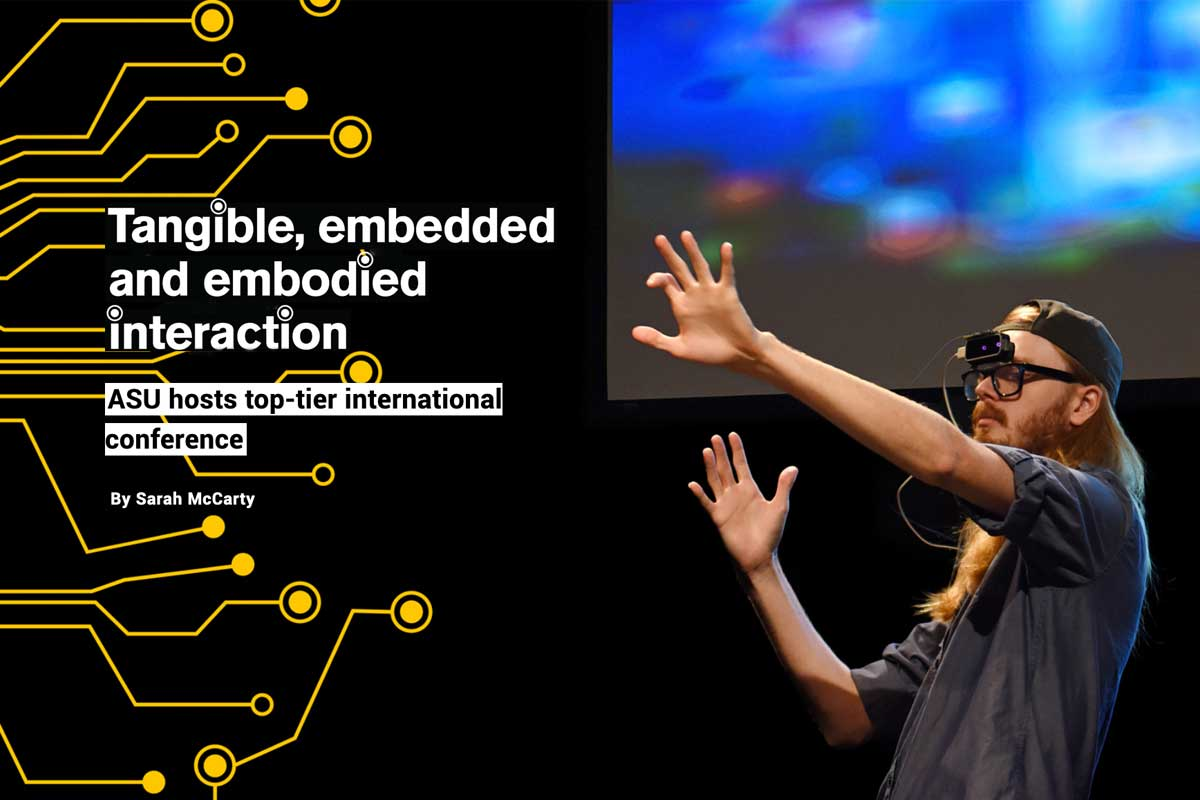 Tangible, embedded and embodies interaction text with young man in VR headset
